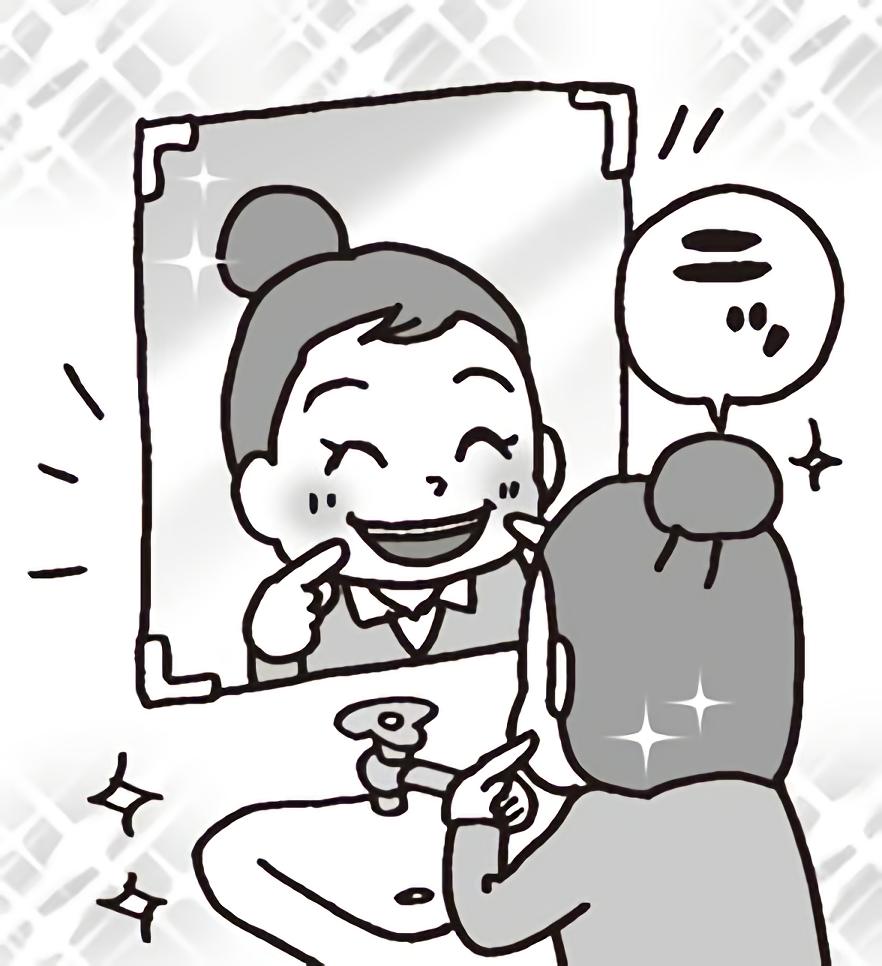 鏡に向かって口角を上げる先生