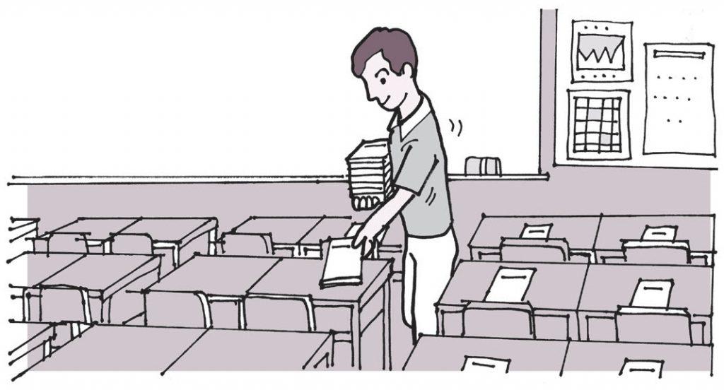前日に集めたノートに○を付けて手本とともに机の上に置いておく先生