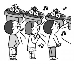 野菜の鉢の前で歌う子供たち