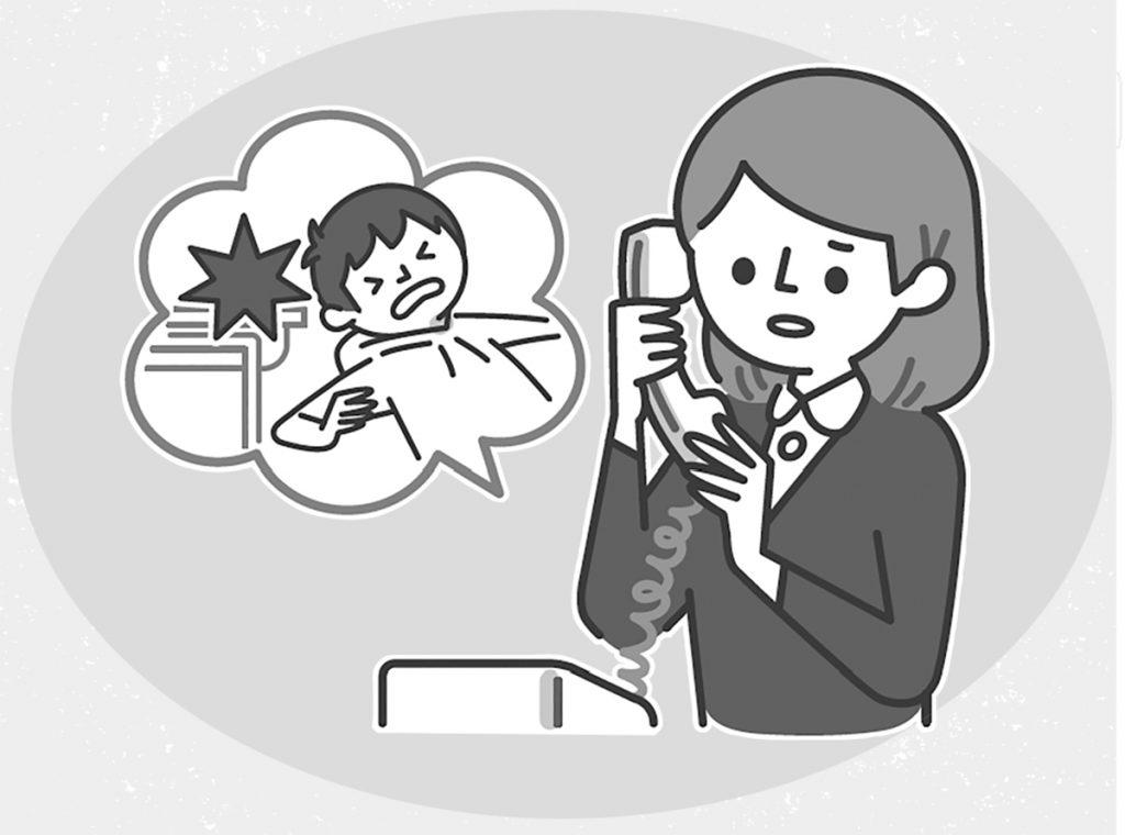 保護者に電話連絡する教師