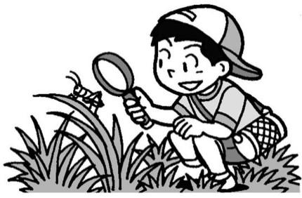 虫眼鏡型の作戦グッズで虫を観察する子供