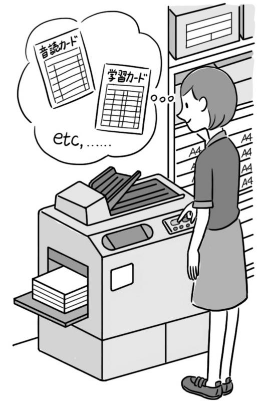 プリントを印刷している教師
