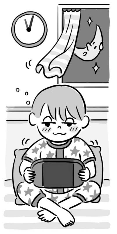 眠いのにゲームをしている子
