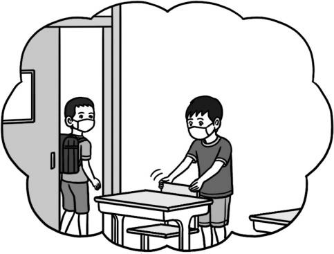 机といすを整頓する子