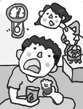 家庭で食事中の子供