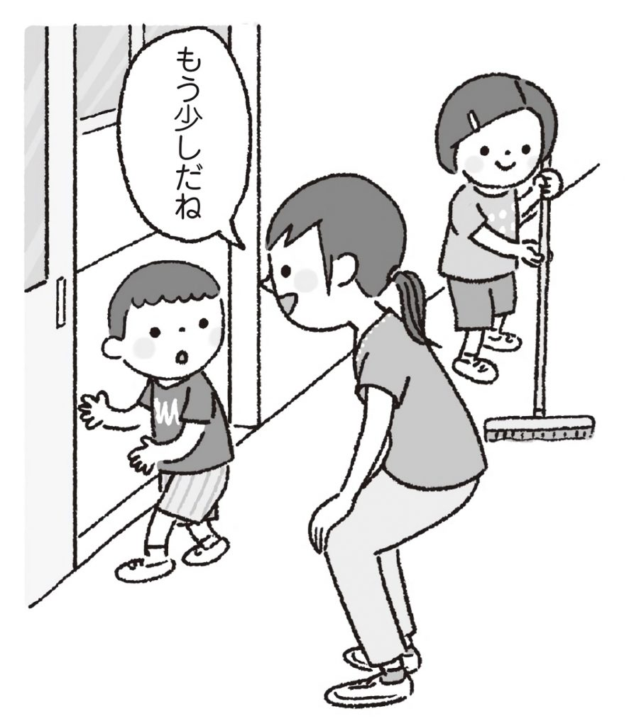 掃除の途中で教室を出て行こうとする男児に声をかける先生。